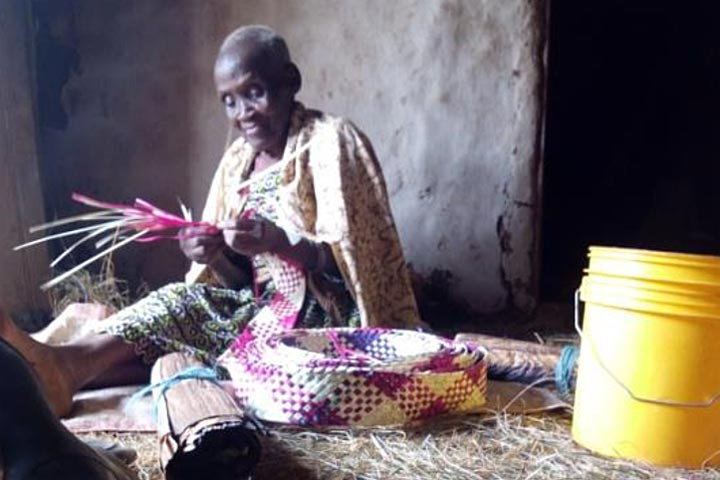 elderly beneficiary of TDT water project