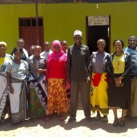 640  Village leaders and young women outside classroom in Ntuntu