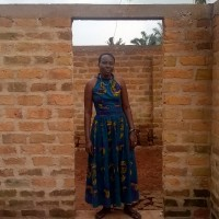 Joyce Nyambo  Chair MWOCDEA women's chickens in new chicken hut
