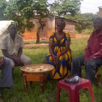 Ihembe Development Association leaders discuss water tank locations in Ikembe