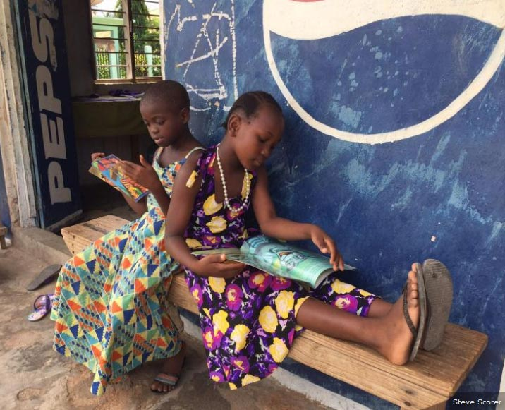 girls enjoying street library in lindi tanzania