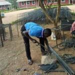 fundis manufacturing chairs and desks, Tunamkumbuka Secondary School